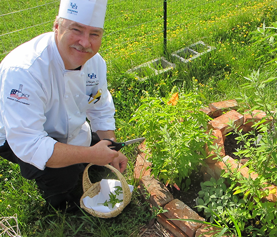 Chef Neil at herb garden